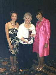 "Gina Dalessandro accepts the ""MBE Supplier of the Year"" award for Quez Media"
